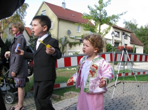 Nathan and cousin Lea blowing bubbles after the wedding