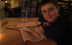 Nathan July 2013 making origami Yoda while they waited in chicago for dinner......