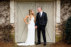 Casey wed front of barn w jeff