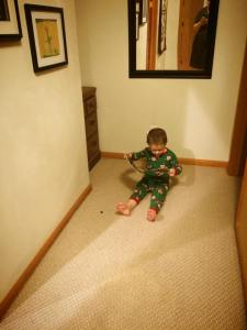 Stephen april 2015 reading lego catalog in hallway half hour after being put to bed