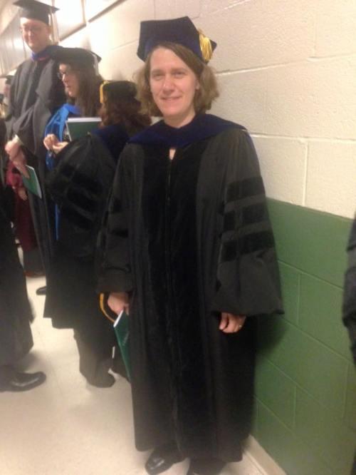 Emily dec 2015 graduation in Palis robe